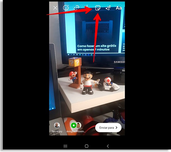 story editing screen, with red arrow pointing to stickers icon